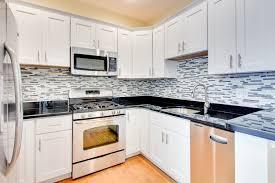 White Kitchen With Hardwood Floors Kitchen White Shaker Kitchen Cabinets Solid Hardwood Flooring