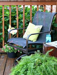 now i need to paint the other chair and the table we have two hard plastic outdoor chairs that are a really dark gray black and the oil rubbed bronze color