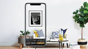plan a perfect gallery wall using art com s new app architectural digest
