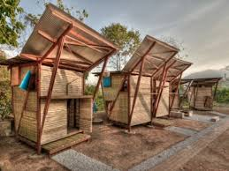 brilliant wooden prefab tiny house with erfly roof added wooden wall as well as stone pavers as small house designs