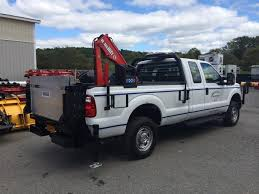 This Ford was outfitted with a Thieman liftgate, Maxilift crane ...
