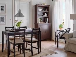 small dining room tables. A Dining Room With Black-brown Table And Chairs Beige Seat Covers Small Tables O