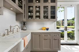 Gray Glass Front Kitchen Cabinets With Carrera Marble Countertops