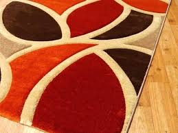 orange and brown area rug hand tufted living room