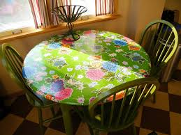 image of elasticized round vinyl tablecloths