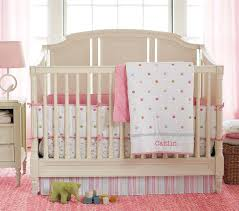 cool large pink braided rug under wicker hamper and neutral wooden furniture in modern baby nursery