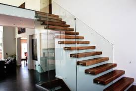 wood floating stairs: modern staircase with wooden steps and glass railing