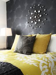 view in gallery mirror above the bed adds glamour to the room design judith balis interiors  on black grey and yellow wall art with cheerful sophistication 25 elegant gray and yellow bedrooms