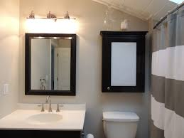 inspiring bathroom with bathroom lighting on the wall plus sink under the mirror ideas