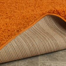 ottomanson ultimate collection solid contemporary living and bedroom area rug orange 5 0 x7 0 ottomanson