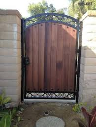 if you need a privacy fence and canu0027t afford thousands for new one can improvise by adding stained wood pickets to your current u2026 iron gates with u71
