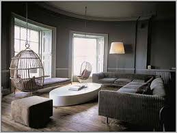 dark grey walls will make for a dramatic and cosy space add reclaimed floorboards for