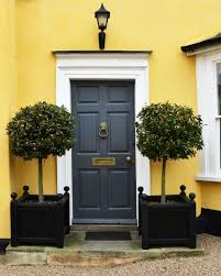 a well balanced front door with bay trees lavenham suffolk england march 2018