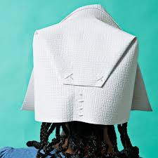 just a few stitches complete the back of this easy pilgrim bonnet