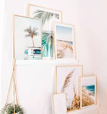 summery posters in oaken frames