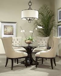 reeeeeally wanting the oh so elegant round gl dining room table my man says it s a go just has to be big enough but a o no on those chairs