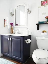 bathroom refresh: traditional bathroom vanity with white framed mirror and satin nickel sconces