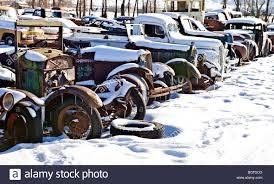 snowy junkyard stock image