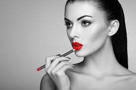 black and white photo of woman painting lipstick beautiful woman face makeup detail beauty girl with perfect skin red lips and nails manicure