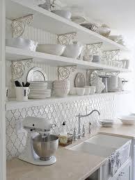 white kitchen with moroccan tile back splash beneath the openshelves