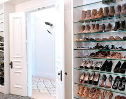 shoe shelves for closet white paneled bi fold doors open to a walk in closet flanked shoe shelves for closet