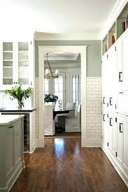 light green walls kitchen with white cabinets lovely tile backsplash