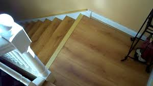 how to lay laminate flooring on stair landing