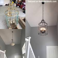 brass chandelier update to look like iron featured on remodelaholic com
