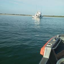 Coast Guard Assists 7 People On Grounded Flooding Boat In
