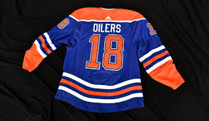 Up until 1979, the crests on the white on the blue jersey, it was white with orange lettering and a blue oil drop. Edmonton Oilers Retro Jersey Uniswag