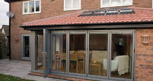 a range of external blinds giving a neat finish to bi folding doors
