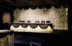le fairy light bridal wedding backdrop with black swagging d with matching le fairy light bridal