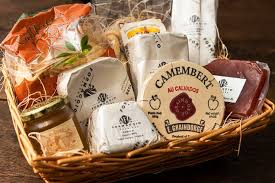 a basket of cheeses preserves and ers