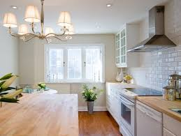white kitchen cabinets with butcher block countertops transitional
