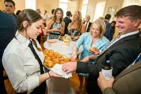 a day in the life of a baton rouge caterer baton rouge business ruffino s catering server gabby dencausse delivers sandwiches to wedding guest during a recent wedding at ruffino s catering at de la ronde hall on third