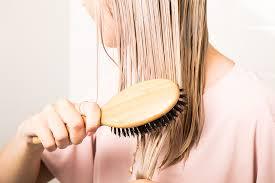 model brushing mask through hair