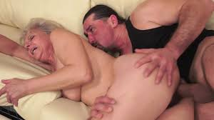 A fat granny is receiving a young cock in her hairy old pussy.