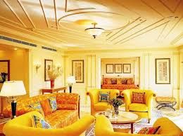 glamorous yellow living room with yellow sofa and chair