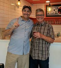 rough draft brewing owner jeff silver left celebrates the of the first beer at his satellite pub at ucsd s mesa nueva housing complex