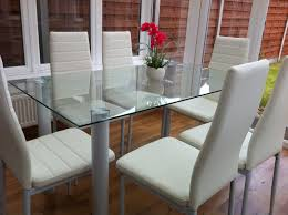 a stunning glass dining table set with gorgeous faux leather chairs choose with 4 or 6 leather chairs available in white and also in black