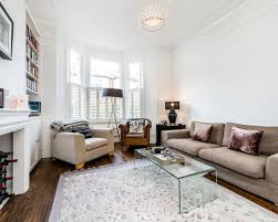 This Is An Example Of A Traditional Living Room In London With White Walls,  Medium
