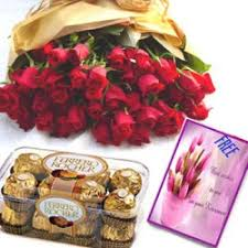 red roses with fererro rocher n free card