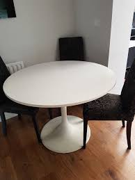 wonderful ikea docksta round white dining table 6 next black and grey paisley patterned
