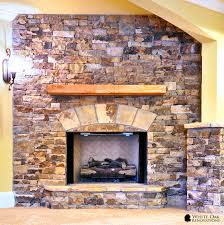 full height ventless fireplace made of dry stacked natural tennessee field stone with a rough cut