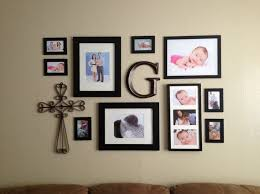 popular wall hanging frame idea 30 family picture collage and black rod on brick