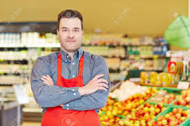 Store Manager Standing With His Arms Crossed In A Supermarket Stock