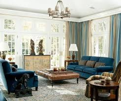 navy blue upholstery, blue and beige draperies, beige room decor and a rich  brown