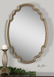 decorative gold mirrors. terelle wall mirror features a decorative oval shape with delicate beading detail around inner edge. frame is finished in lightly antiqued gold leaf mirrors