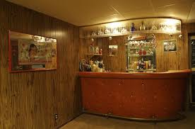 here s a curved basement bar with overhead wine glass racks