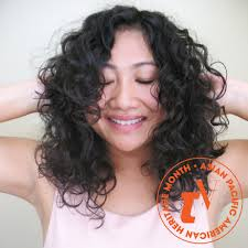 Asian with curly hair